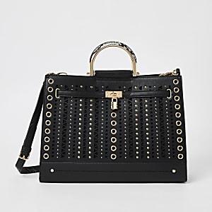 Zwarte handtas met studs en uitsnede