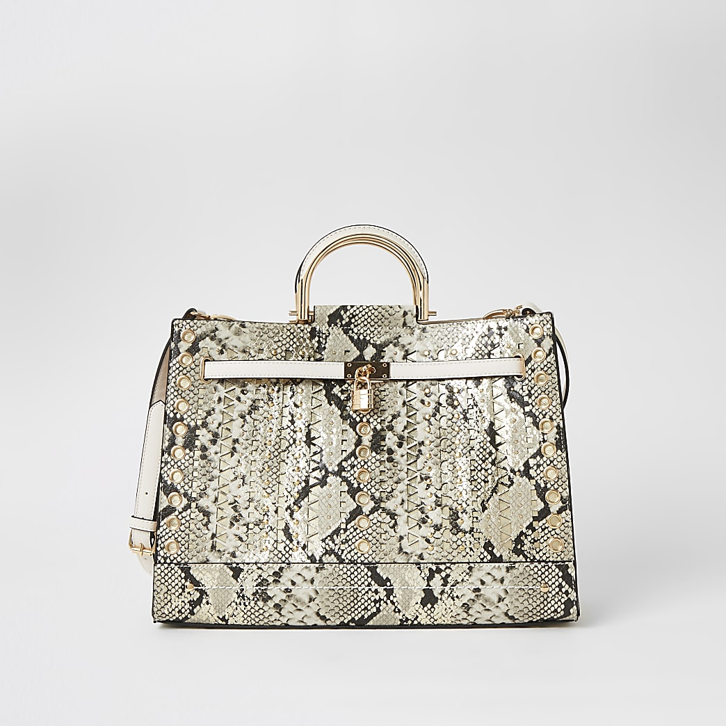 Beige snake print studded cut out tote bag