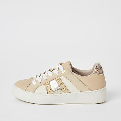 Beige studded lace-up trainers