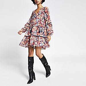 Robe rose imprimée à smocks et manches longues