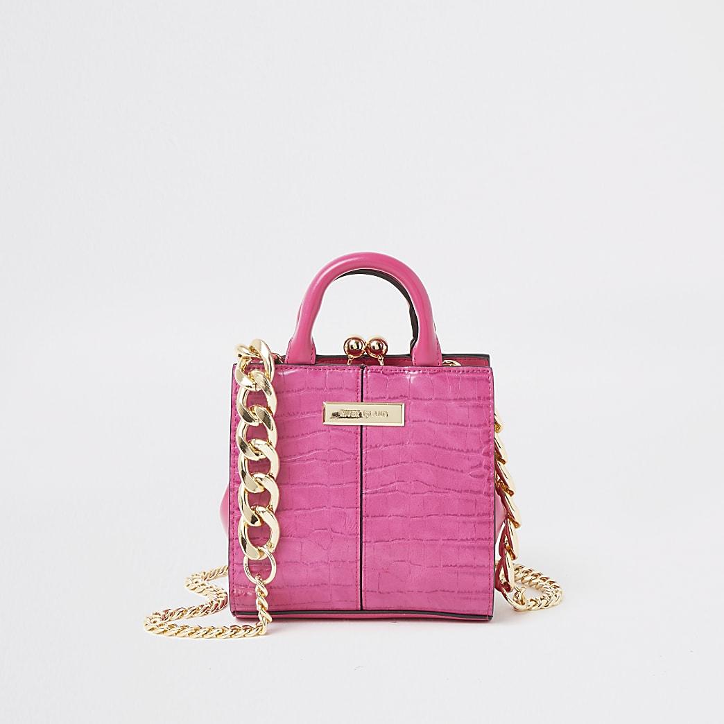 Roze mini-tas met krokodillenprint in reliëf en druksluiting