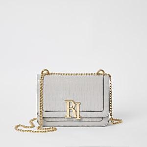 Grijze satchel schoudertas met RI-letters in reliëf