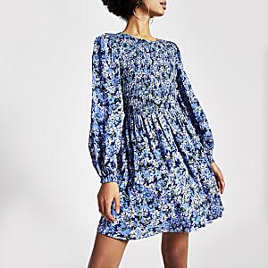 Mini-robe bleue fleurie froncée à manches longues