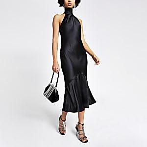 Zwarte satijnen midi-jurk met striksluiting achter