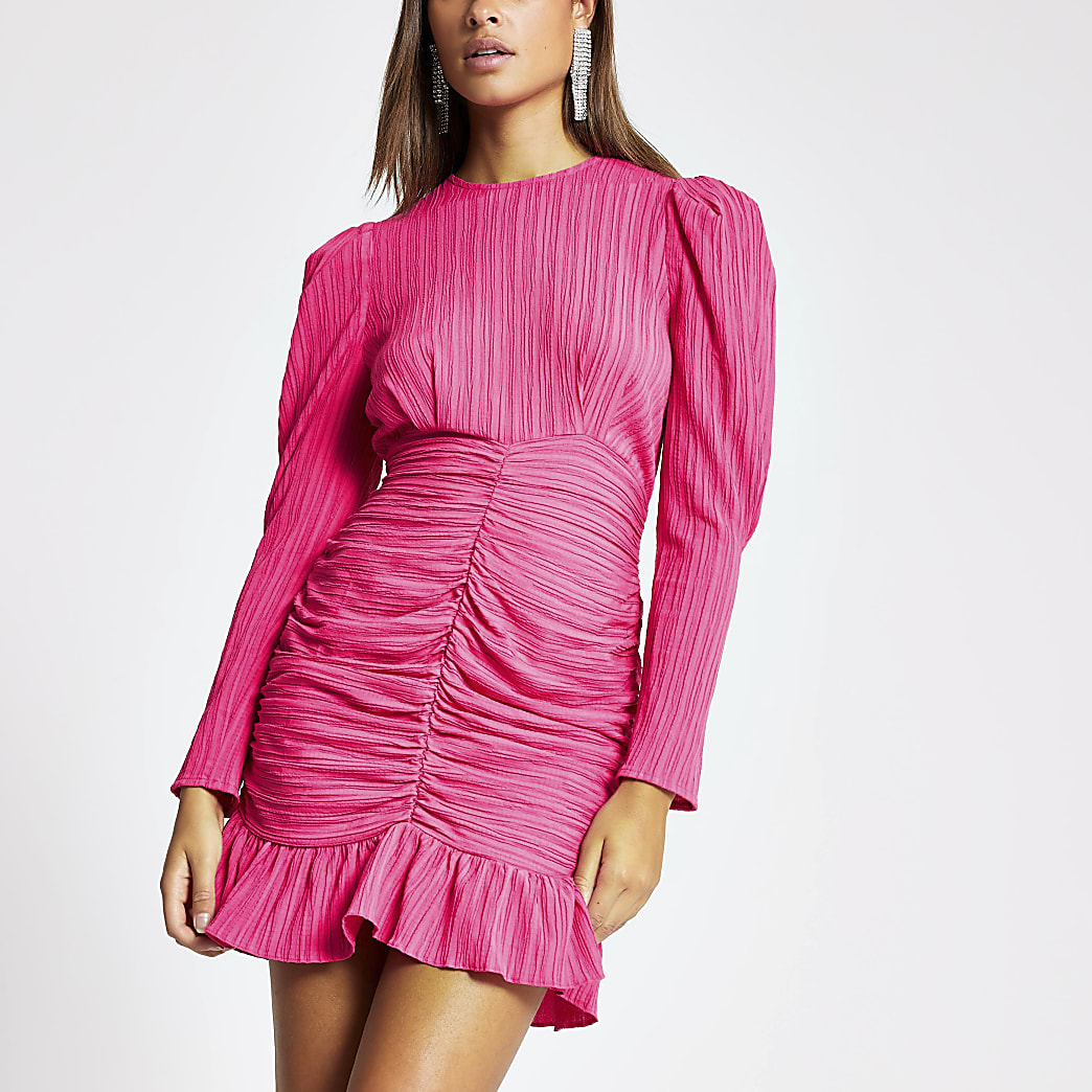 Pink textured long sleeve ruched mini dress