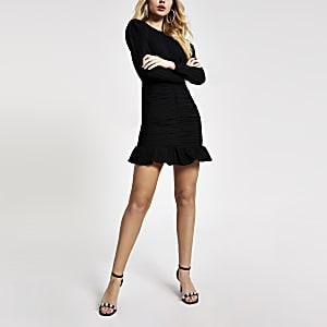 Zwarte mini-jurk met textuur, lange mouwen en ruches