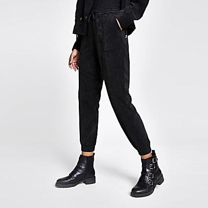 Black corduroy jogger trousers