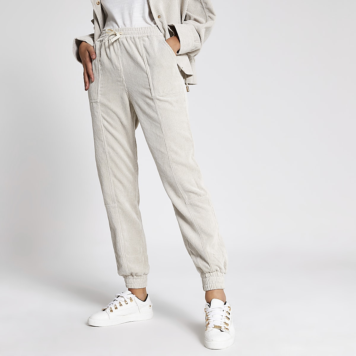 Cream corduroy jogger trousers