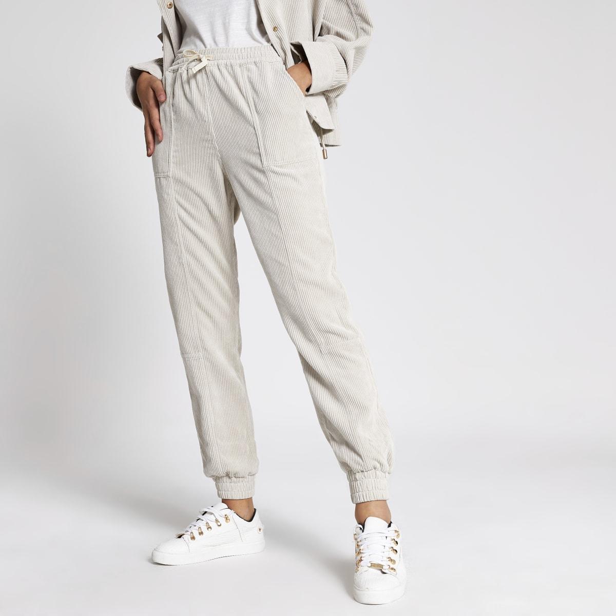 Cream corduroy jogger trousers