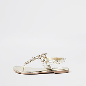 Sandales tong dorées ornées