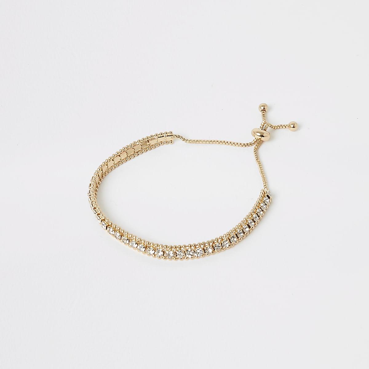 Goudkleurige armband bezet met siersteentjes