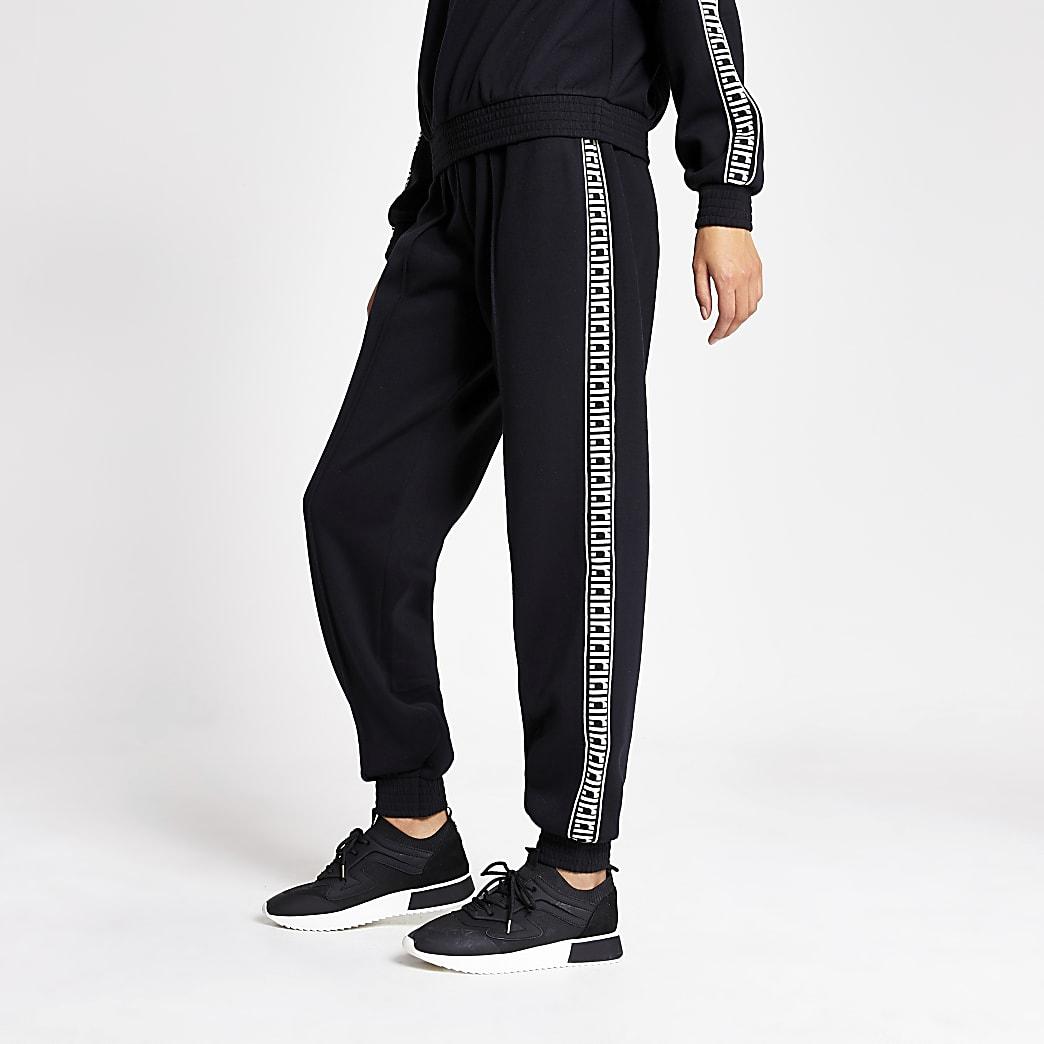 Pantalons de jogging noirs larges avec monogramme RI sur lecôté