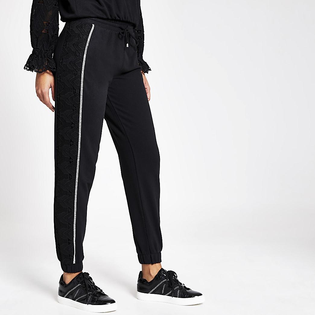 Zwarte loose-fit joggingbroek met broderie langs zijkant