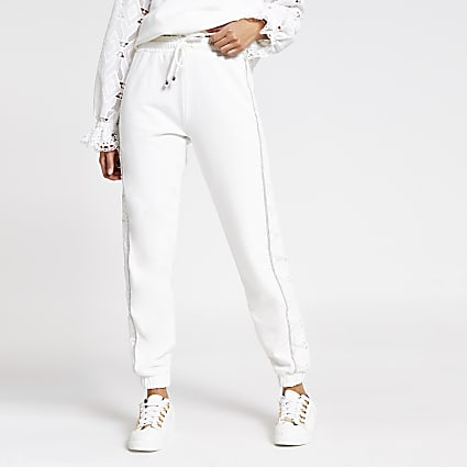White broderie diamante side joggers
