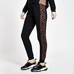 Schwarze Jogginghose in Blockfarben mit Animal-Print