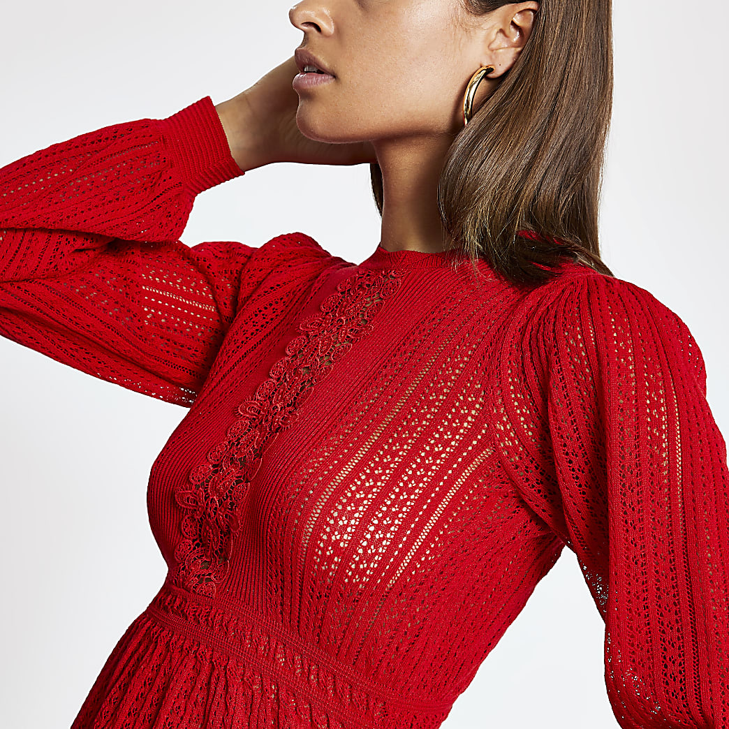 Rode gebreide trui met peplum en kant