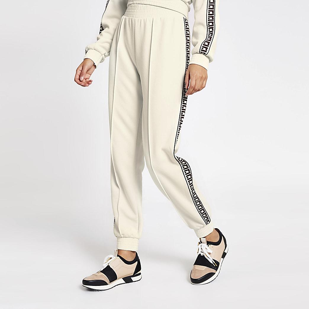 Crèmekleurige loose-fit joggingbroek met RI-bies aan zijkant