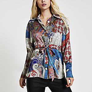 Langärmelige, cremefarbene Bluse mit Taillenband und Print