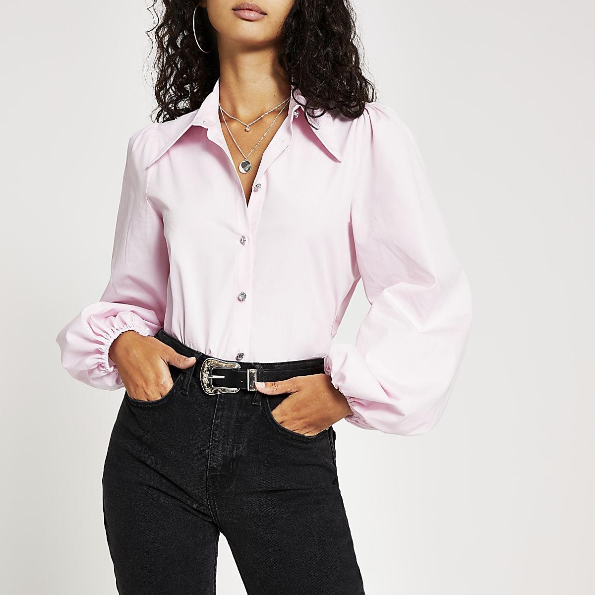 Chemise roseà manches longues bouffantes