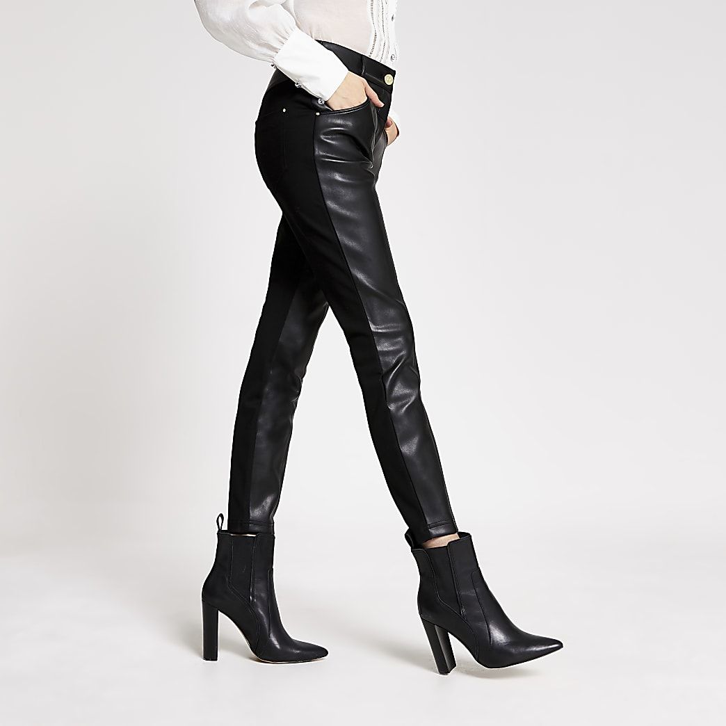 Pantalons skinny noirs en cuir synthétique et point de Rome