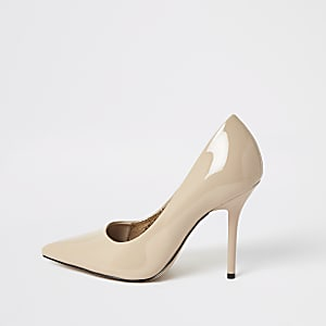 Pink patent pointed toe heeled court shoes