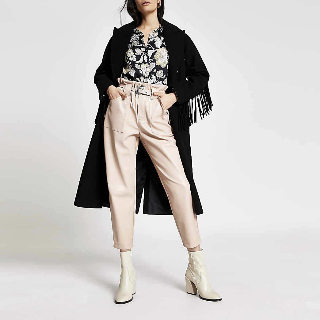 Pink faux leather belted peg trousers