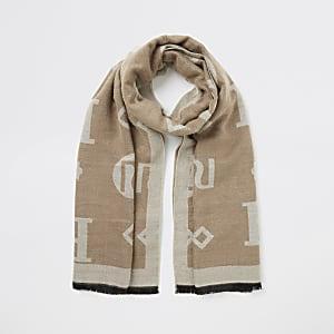 Beige jacquard sjaal met RI-monogram