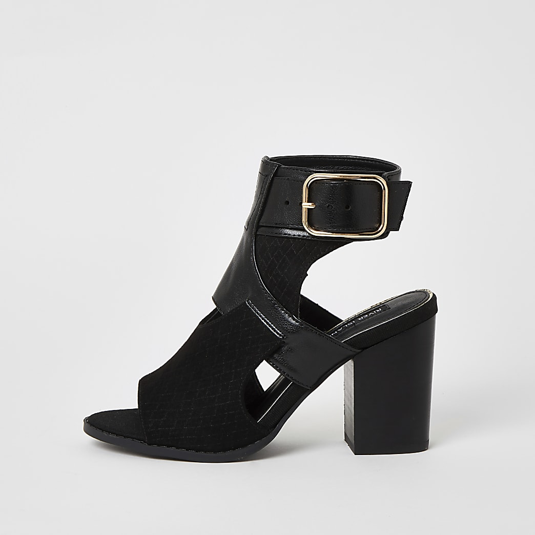 Black cut out heeled shoe boots