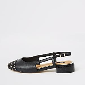 Schwarze Schuhe mit niedrigem Blockabsatz und Nieten