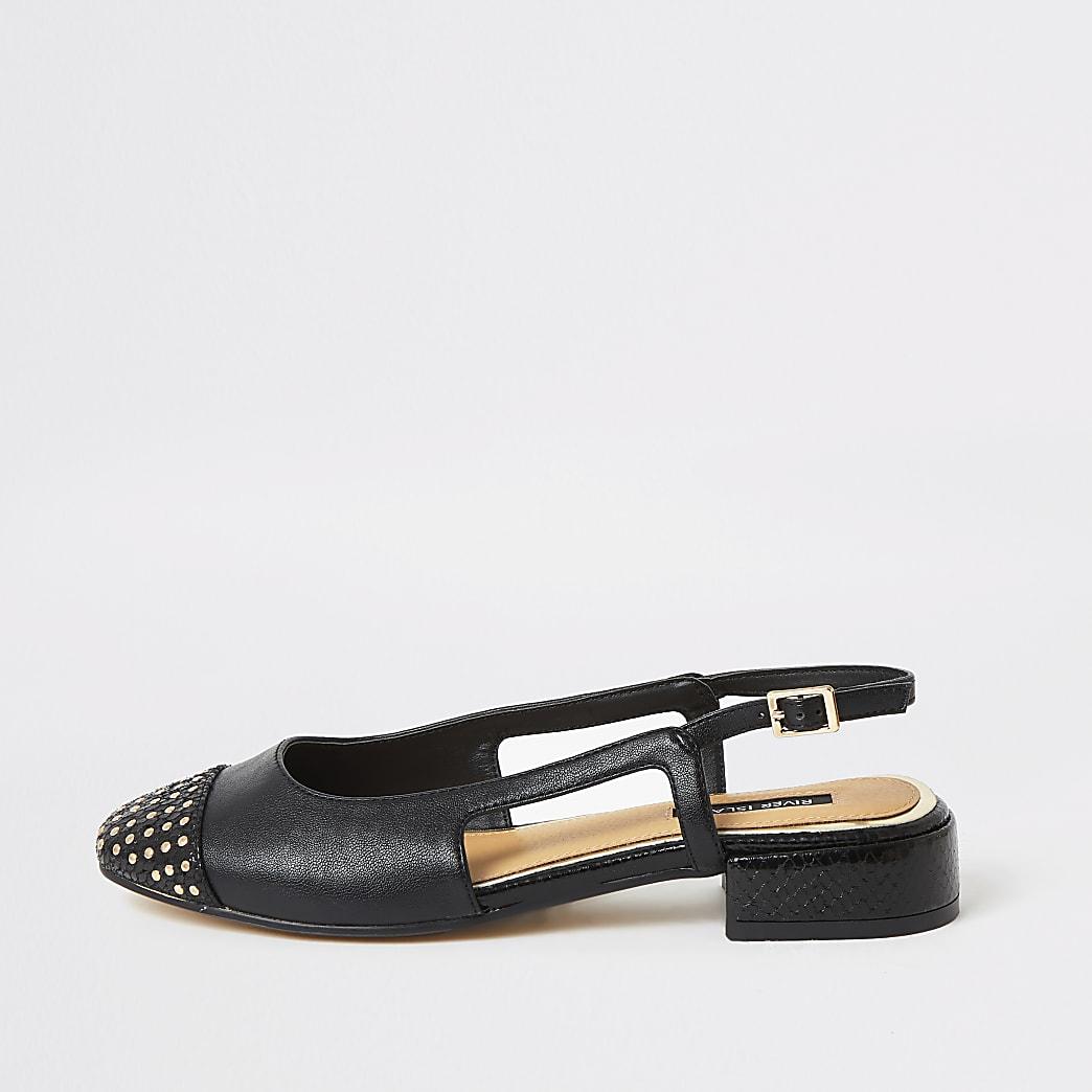 Zwarte schoenen met lage blokhak en studsop de neus