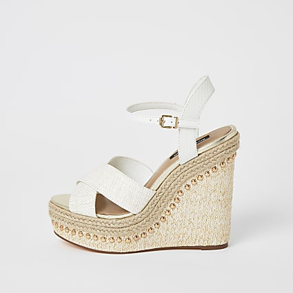 White studded cross strape wedge sandals