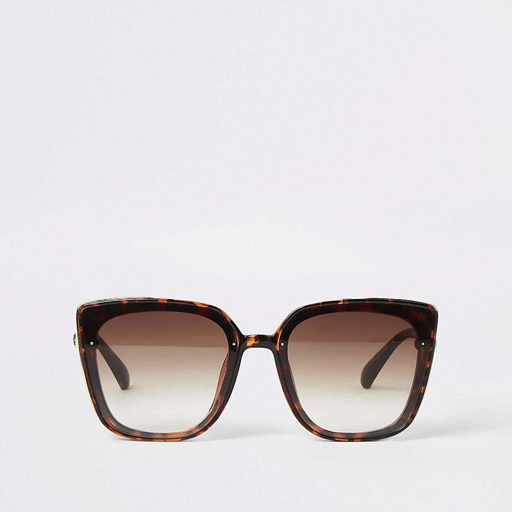 Bruine glam zonnebril met schildpadprint en goudkleurige zijkant