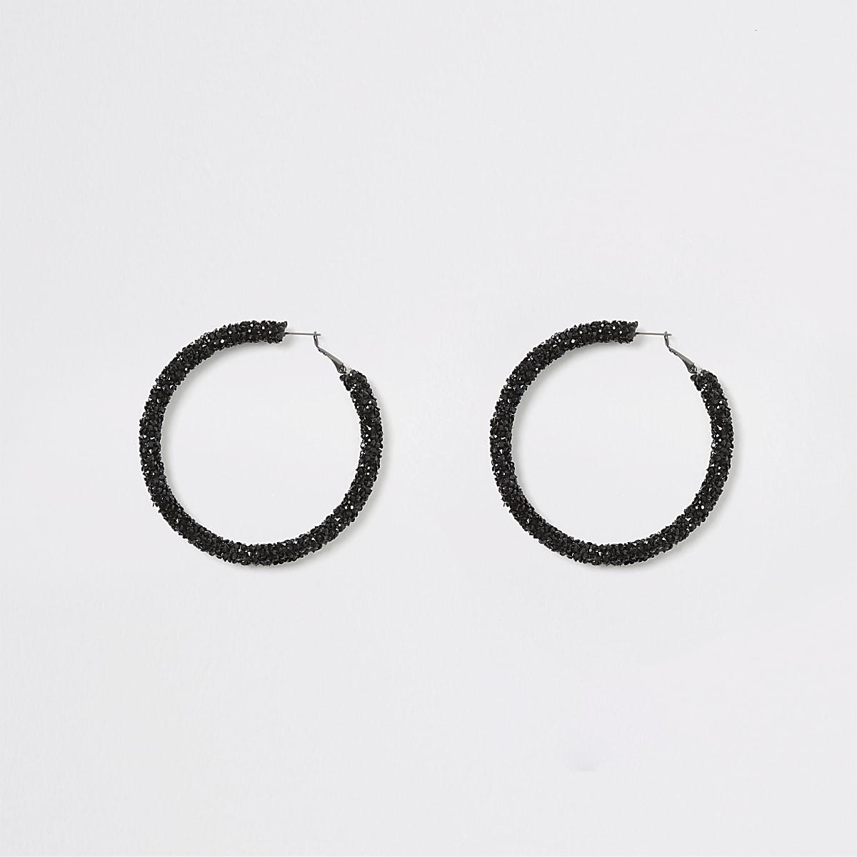 Zwarte ronde oorbellen verfraaid met glitters