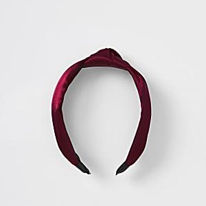 Donkerrode satijnen haarband met knoop
