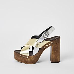 Goudkleurige - Leren sandalen met kruislingse bandjes en plateauzool
