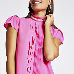 Pinkfarbene Bluse mit Perlen am Ausschnitt und Rüschen vorne