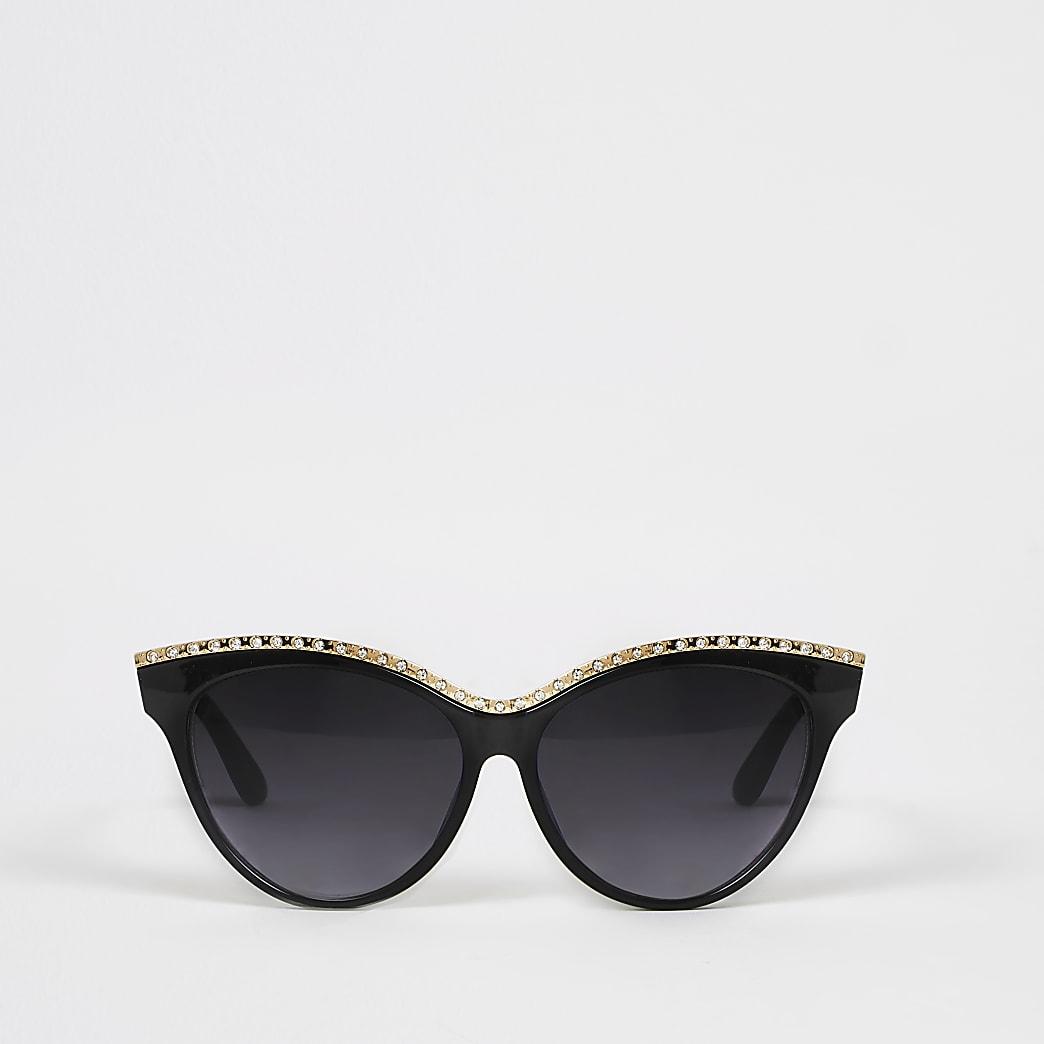 Zwarte verfraaide zonnebril met kattenoogmontuur en siersteentjes