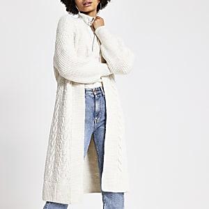 Crèmekleurige gebreide kabeltrui maxi vest met strik ceintuur