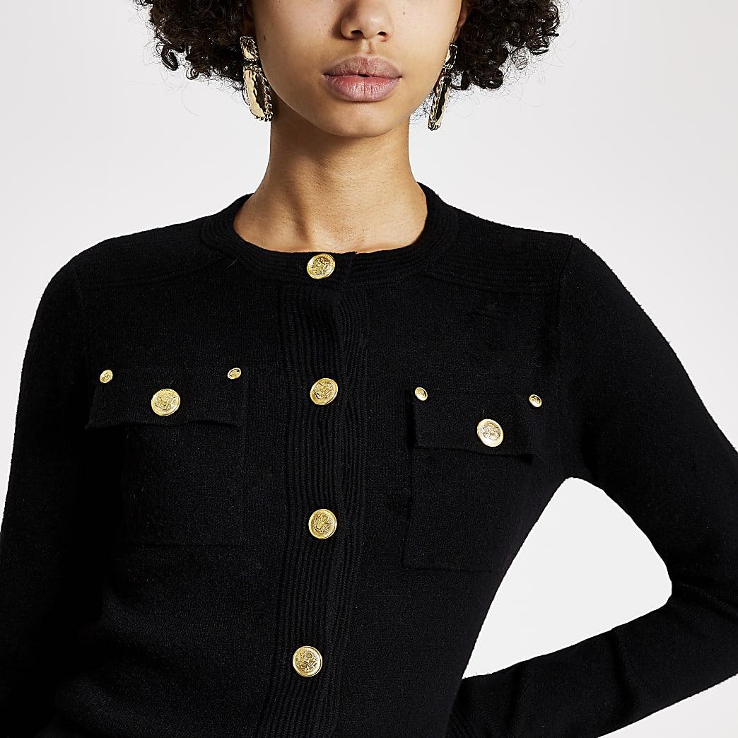 Zwart gebreid vest met knopen aan de voorkant