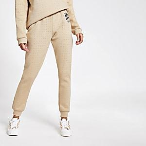 Pantalons de jogging RI beige ornés