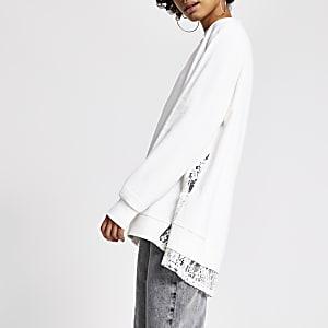 Cremefarbenes Sweatshirt mit Strass und Zierstreifen aus Spitze