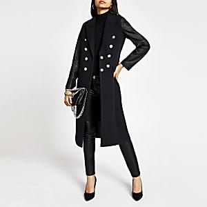 Manteau long bleu marine avec manches en cuir synthétique