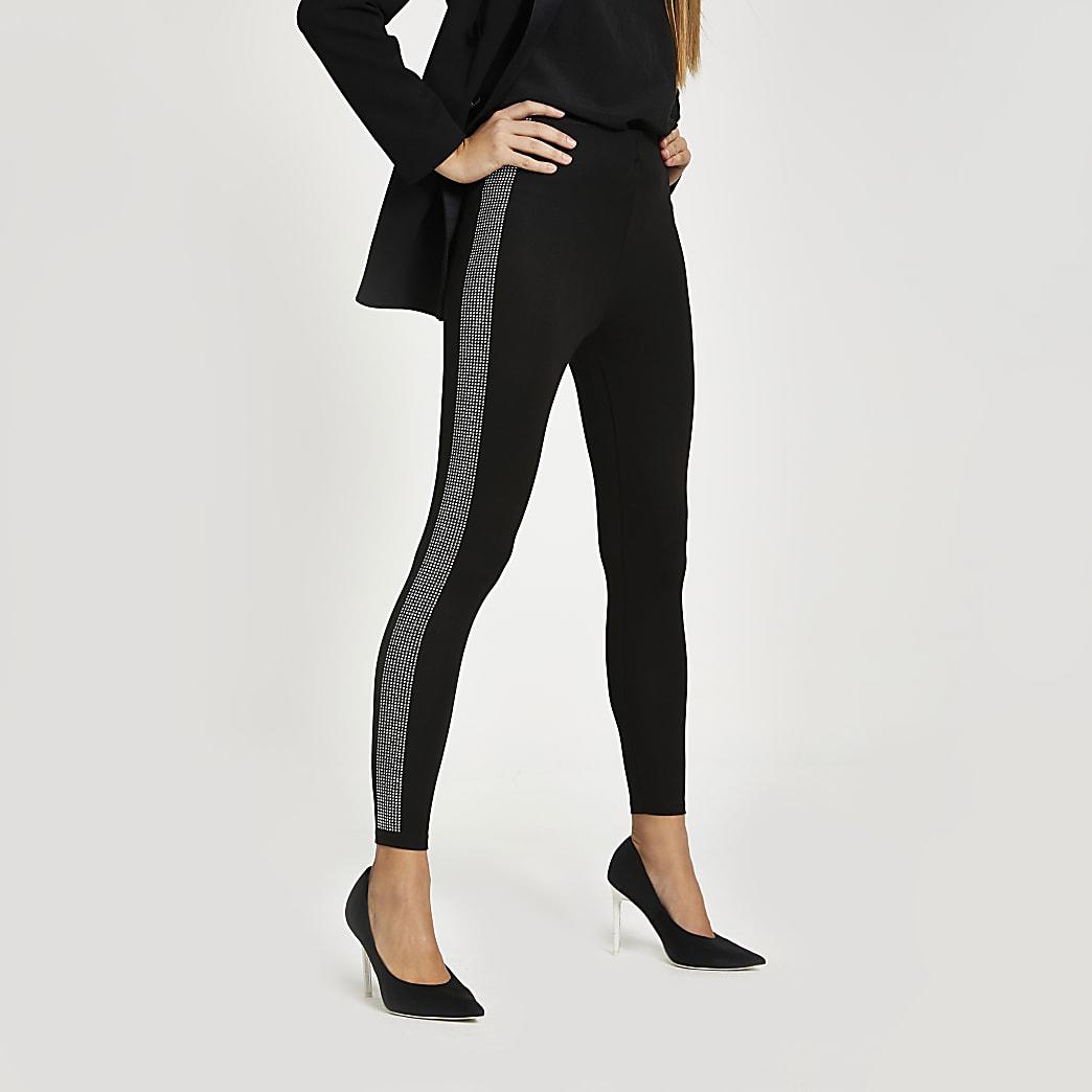 Zwarte leggings met siersteentjes langs de zijkant