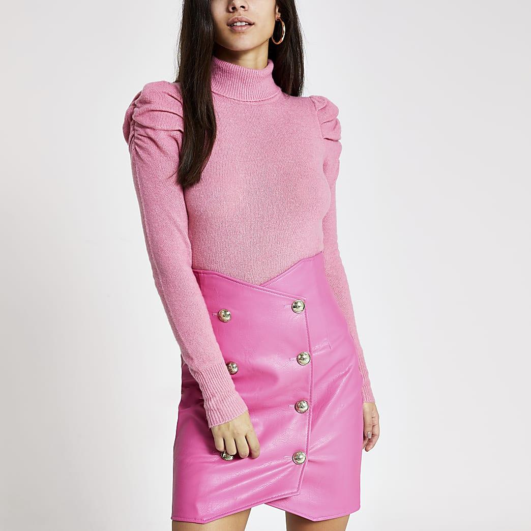 Mini-jupe en cuir synthétique rose taille haute