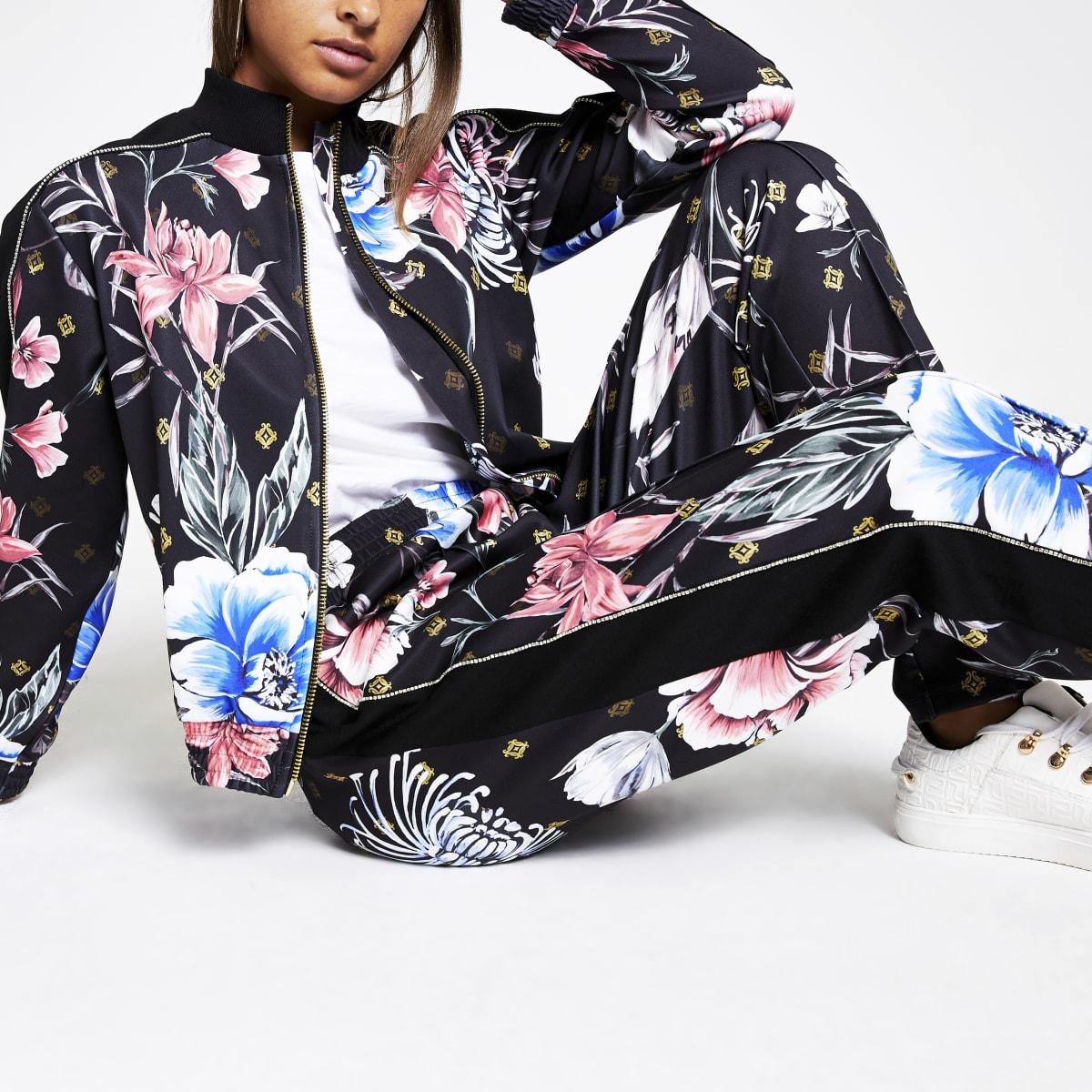 Pantalon de jogging fuselé noir à strass sur le coté et motif floral