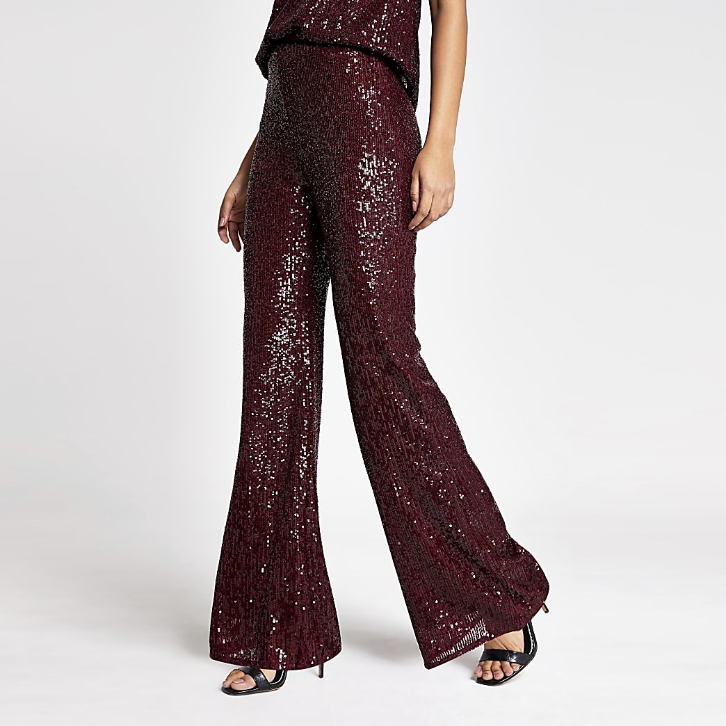 Dark red sequin embellished flare trousers
