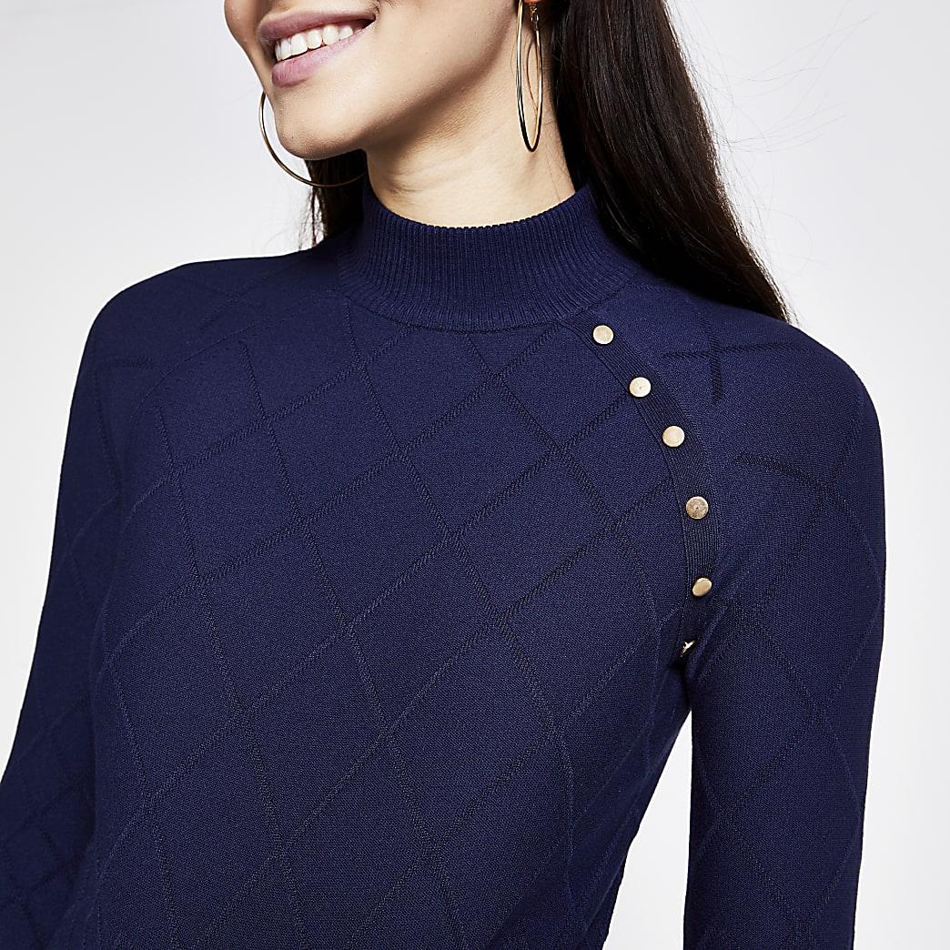 Marineblauwe gewatteerde hoogsluitende pullover met knopen
