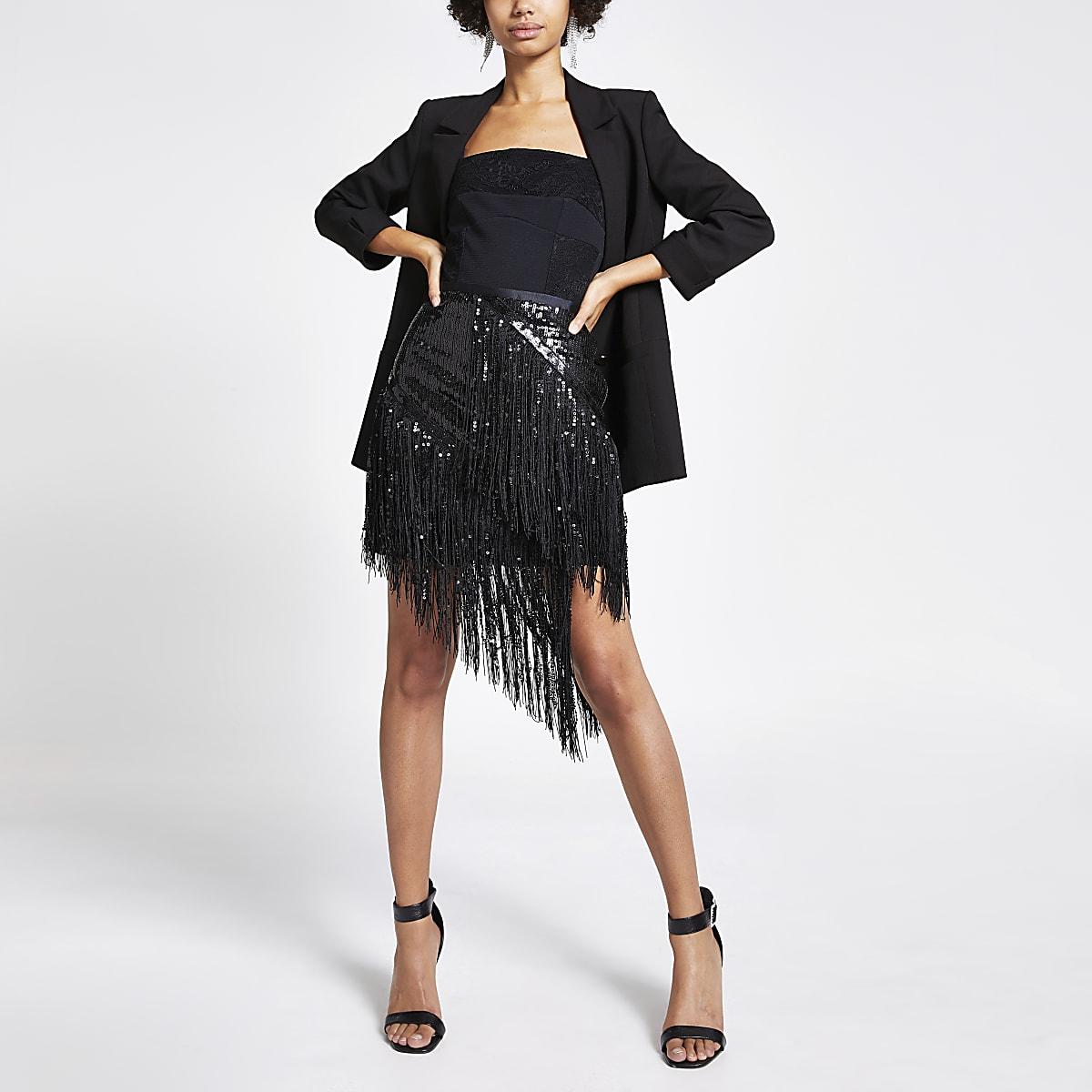 Jupe noire asymétriqueà sequins et franges