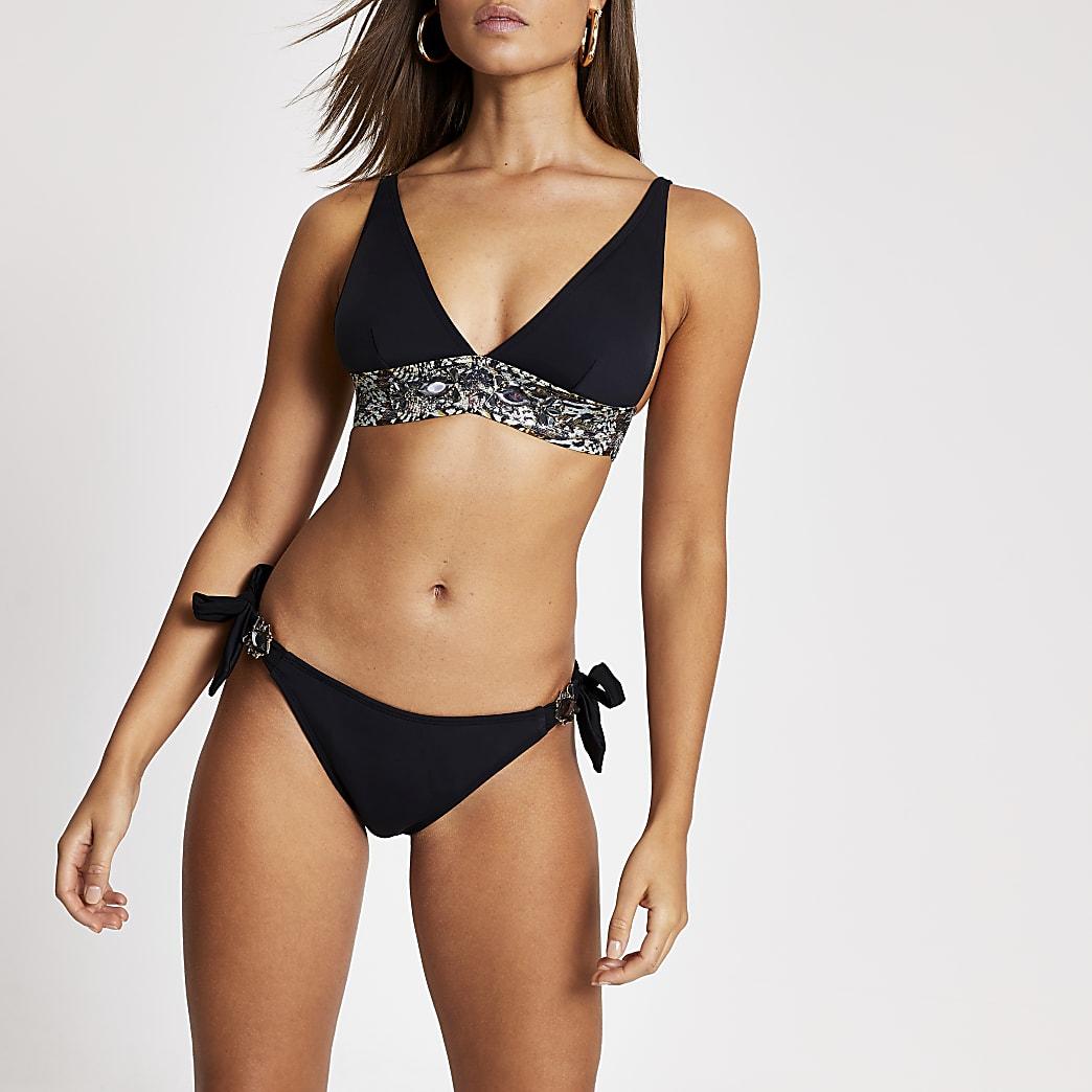 Bas de bikini noir avec liens à nouer sur les côtés ornés