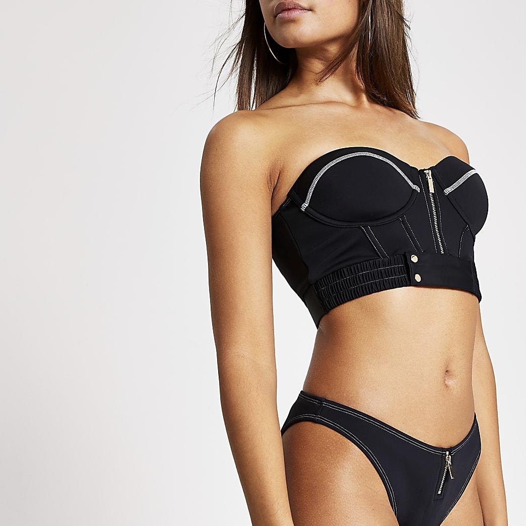 Zwarte balconette bikinitop met halve ritssluiting en stiksels